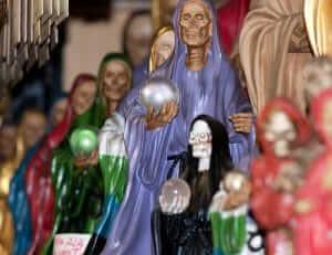oracion a la santa muerte morada